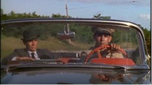 With the first shot, we see Bond driving with the suspicious man and take note of Bond's precautionary glances.