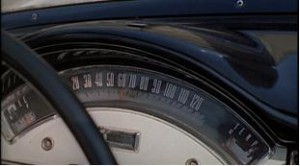 In the third shot we see the speedometer, as Bond notes that the driver has sped up. 