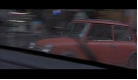 The shot selection is constantly changing perspectives and challenging how we view the action. We move from the street, to inside Bourne's car looking out, to outside Bourne's car looking in, and finally to POV shots through the windshields of squad cars and civilians cars alike. There is often no fixed axis to orientate the viewer.