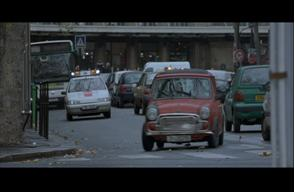 Initially, two police cars are pursuing Bourne. However, the film edits from their chase to a shot of two motorcycle policemen joining the fray. These shots are combined without offering any method to know where the motorcyclists stand spatially in the chase. More importantly, they mirror the duality of threat seen in the Bond chase. However, instead of the calm repose offered through Dr. No's editing, here the chase simply spirals chaotically.