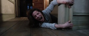 Lili Taylor gets dragged around the house in The Conjuring