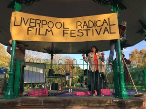 LRRF activists arrange a banner at an outdoor screening