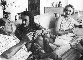 Jeanne Moreau comes between Buñuel and his wife, Jeanne Rucar